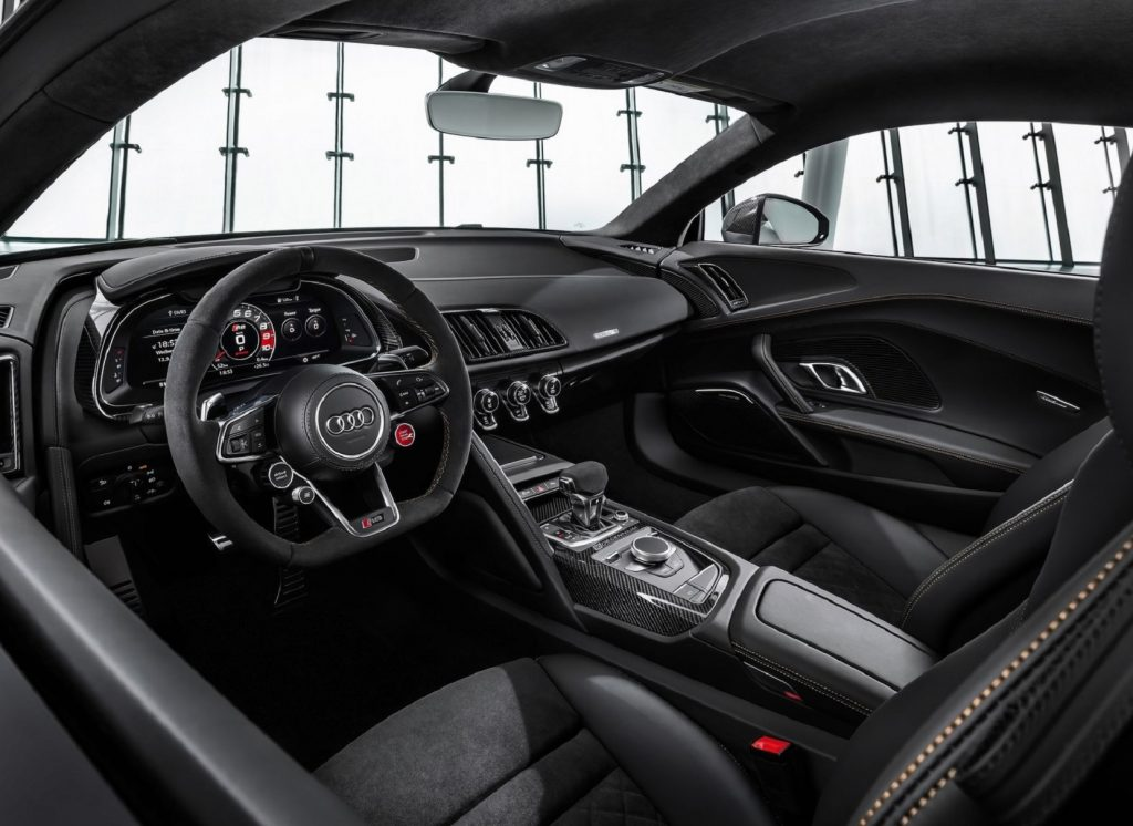 The black-and-carbon-fiber-trimmed interior of a 2020 Audi R8 V10 Decennium