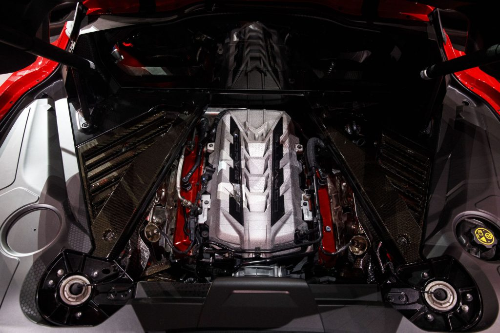 The engine of a red 2020 Chevy Corvette C8 Stingray sports car on display during an unveiling event in Tustin, California, in July 2019