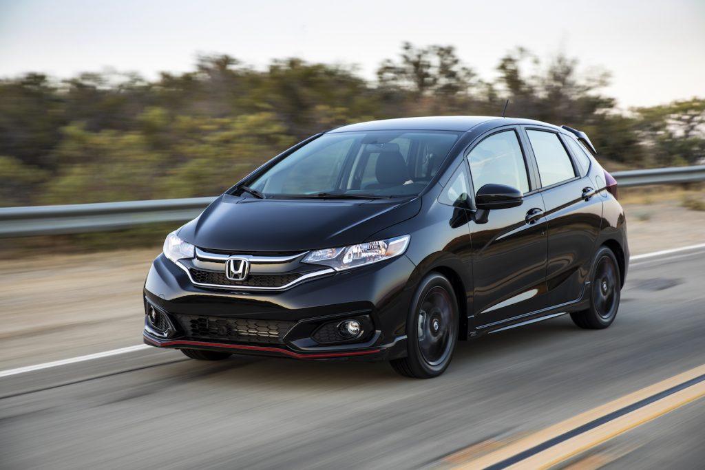 A 2020 Honda Fit driving down a road