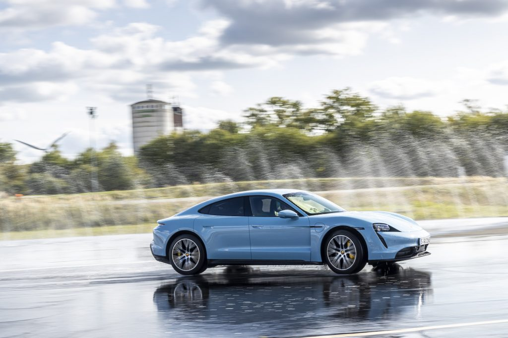 A sky-blue Porsche Taycan 4S electric sedan at the Taycan Regional Tour 2020 in Lüneburg, Germany