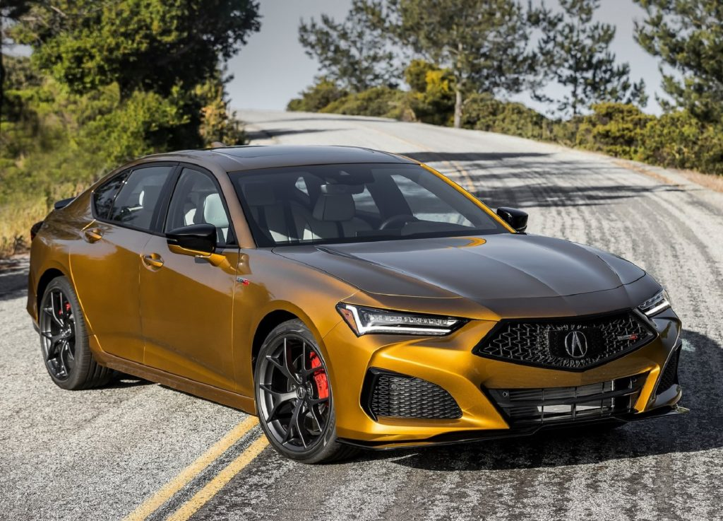 A gold 2021 Acura TLX Type S on a twisting mountain road