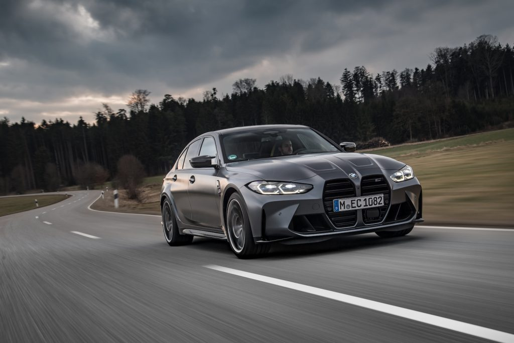 A 2021 BMW M3 driving