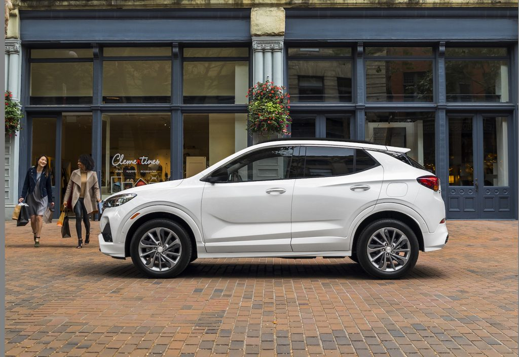 A white 2021 Buick Encore GX in front of a store, the Encore GX is one of the best affordable luxury cars under $35,000