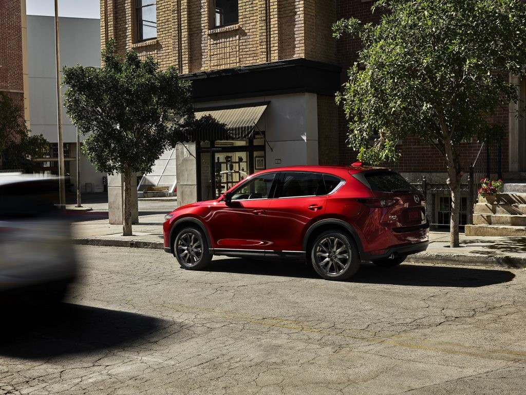 A red 2021 Honda CR-5 subcompact SUV parked on a city street