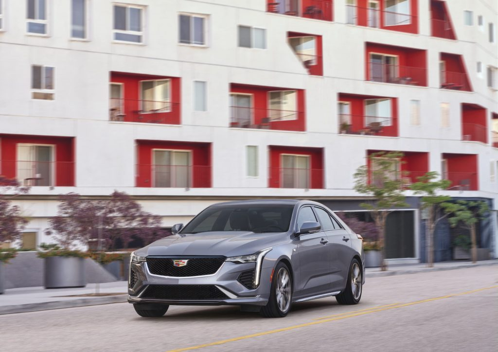A silver 2021 Cadillac CT4 driving, one of the best affordable luxury cars under $35,000