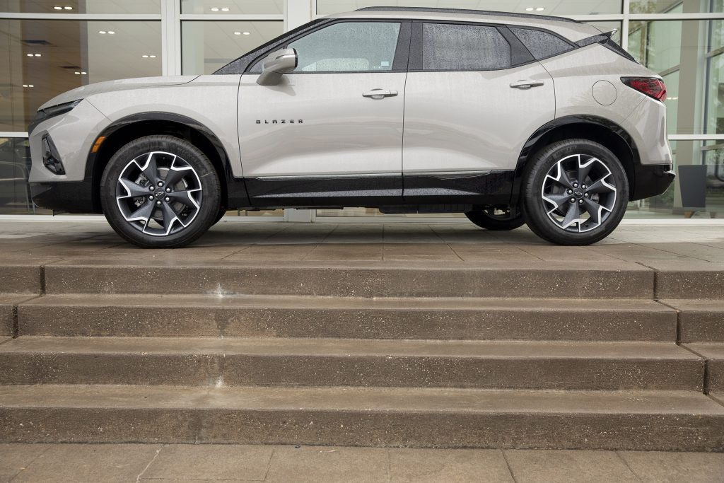 A 2021 Chevy Blazer sits on the stairs of a dealership.