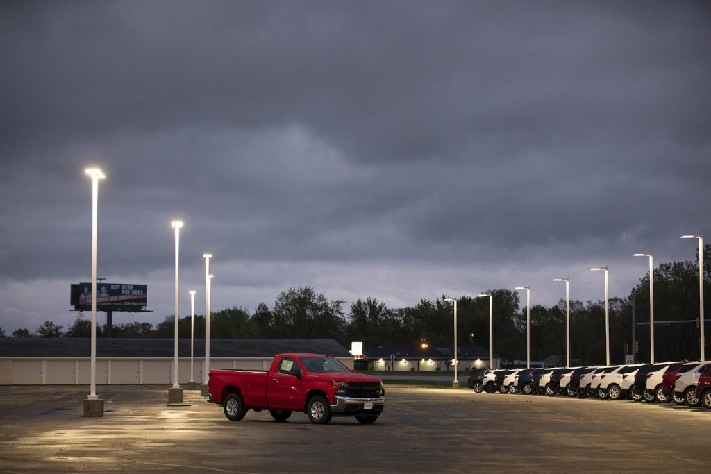 A red 2021 Chevy Silverado in an empty parking lot