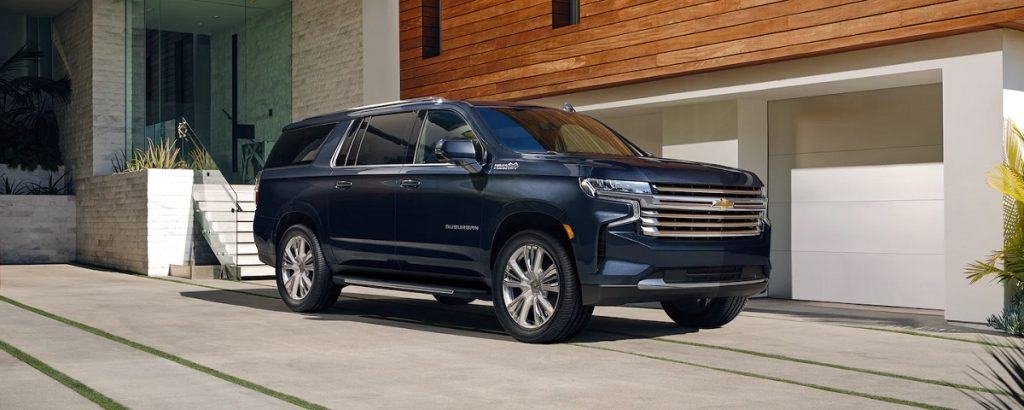 One of the safest large SUVs, a 2021 Chevy Suburban, sits outside of a house.