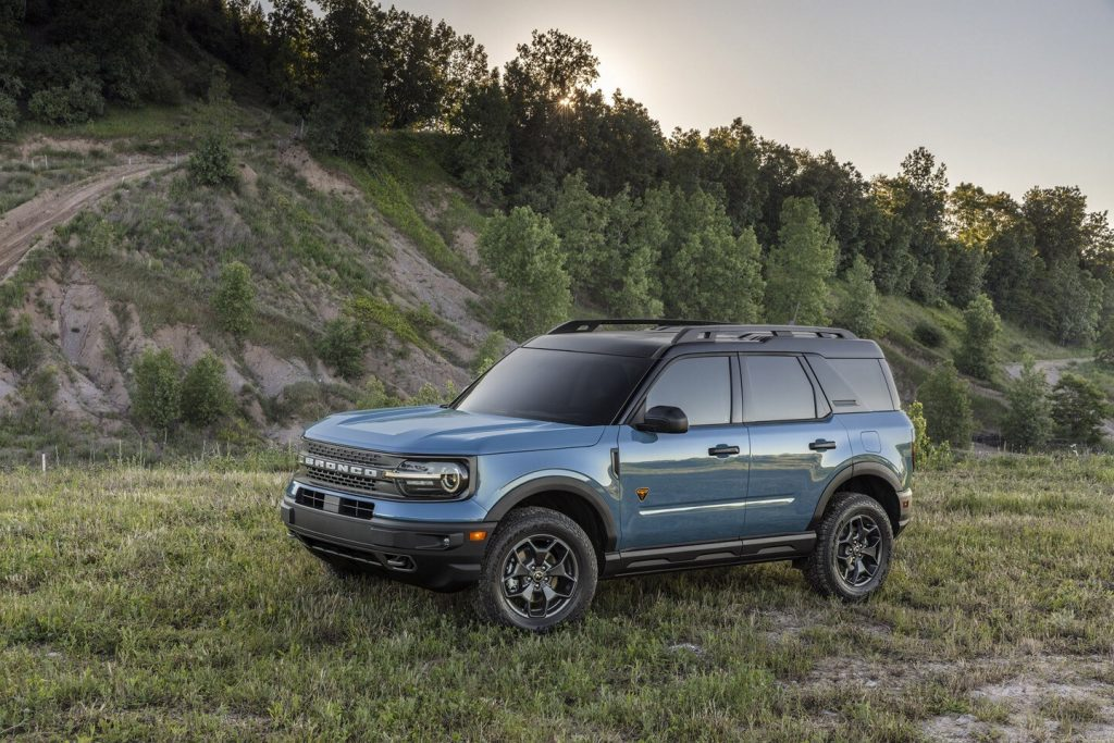 A blue 2021 Ford Bronco Sport Badlands parked on the grass next to a hill in Area 51