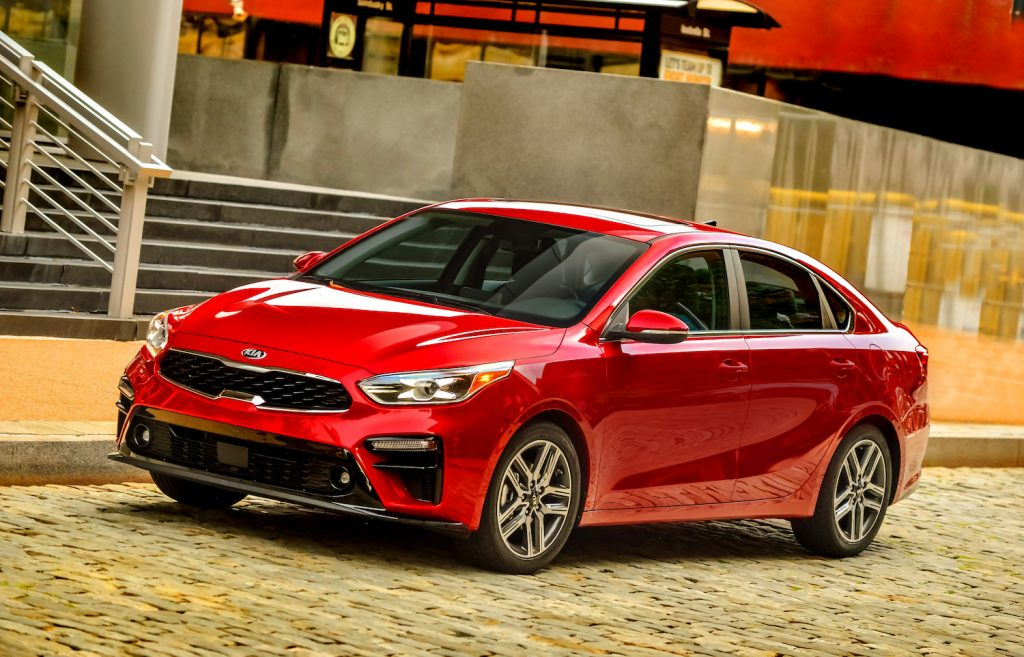 A red 2021 Kia Forte driving