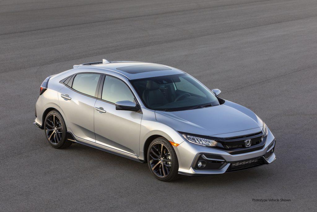 A silver 2021 Honda Civic Hatchback Sport Touring parked on asphalt