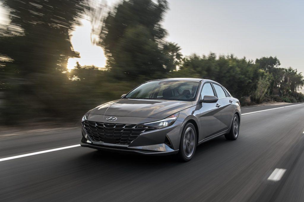A dark grey 2021 Hyundai Elantra Hybrid driving