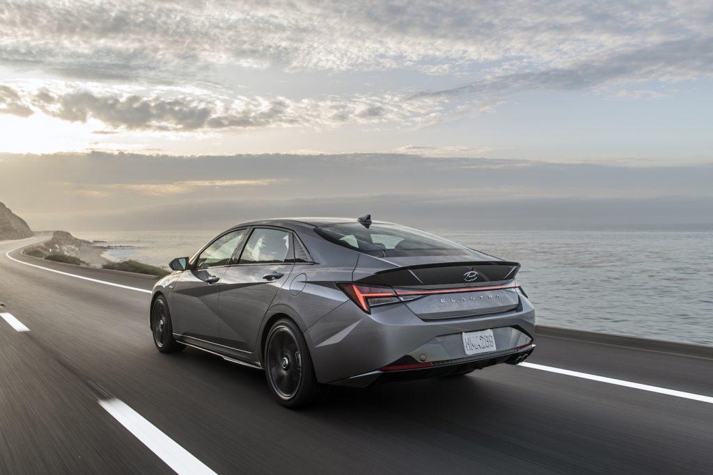 A silver 2021 Hyundai Elantra N Line driving, the 2021 Hyundai Elantra N Line is one of the best new cars with a manual transmission