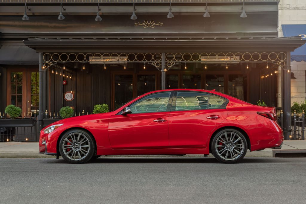 A red 2021 Infiniti Q50 parked, the Q50 is among KBB's picks for the best affordable luxury cars