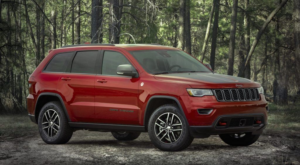 Pictured is the 2021 Jeep Grand Cherokee Trailhawk in the wilderness, the Grand Cherokee is one of the best SUVs for camping