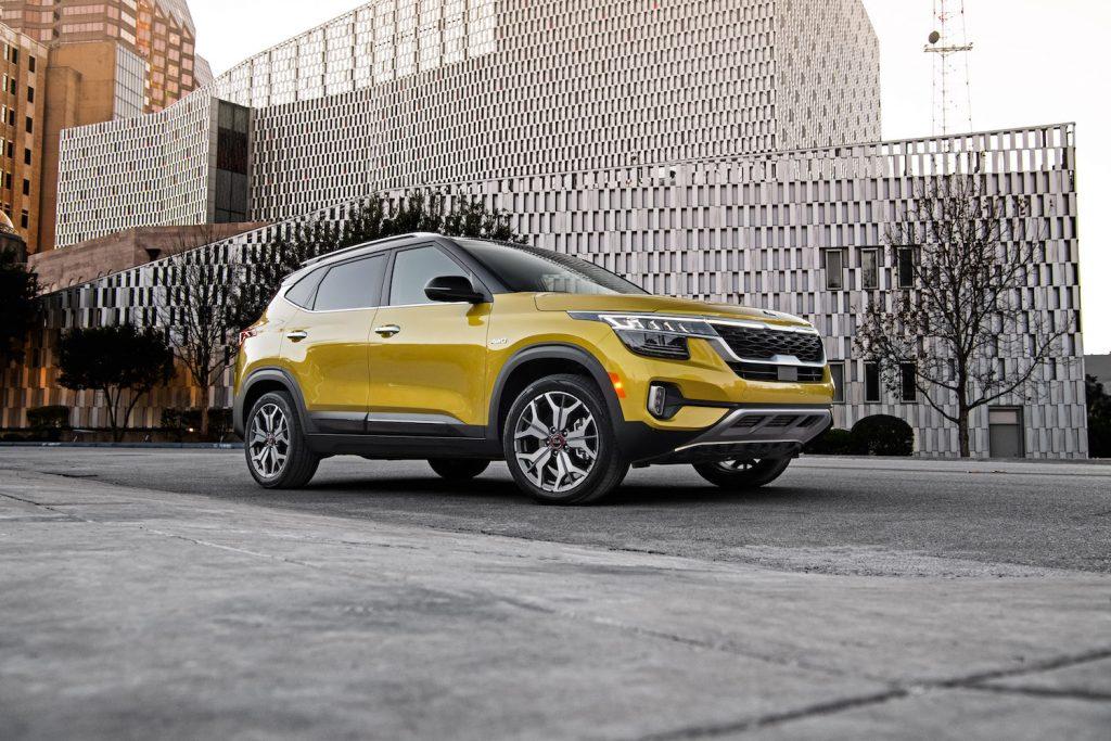 A yellow 2021 Kia Seltos parked