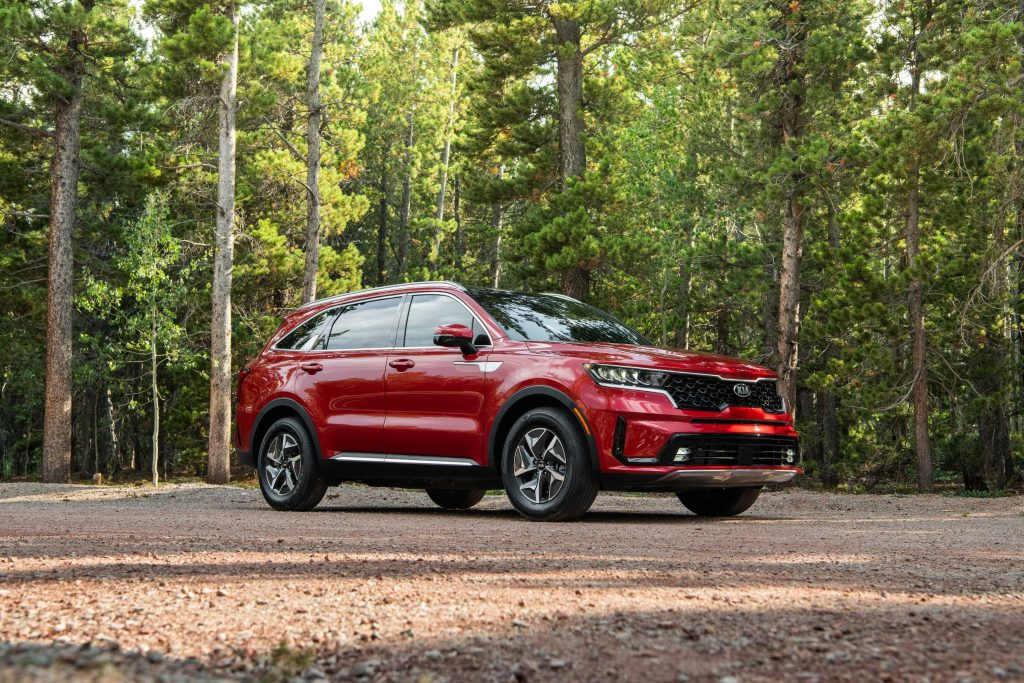 The red 2021 Kia Sorento HEV Hybrid parked in the middle of a forest