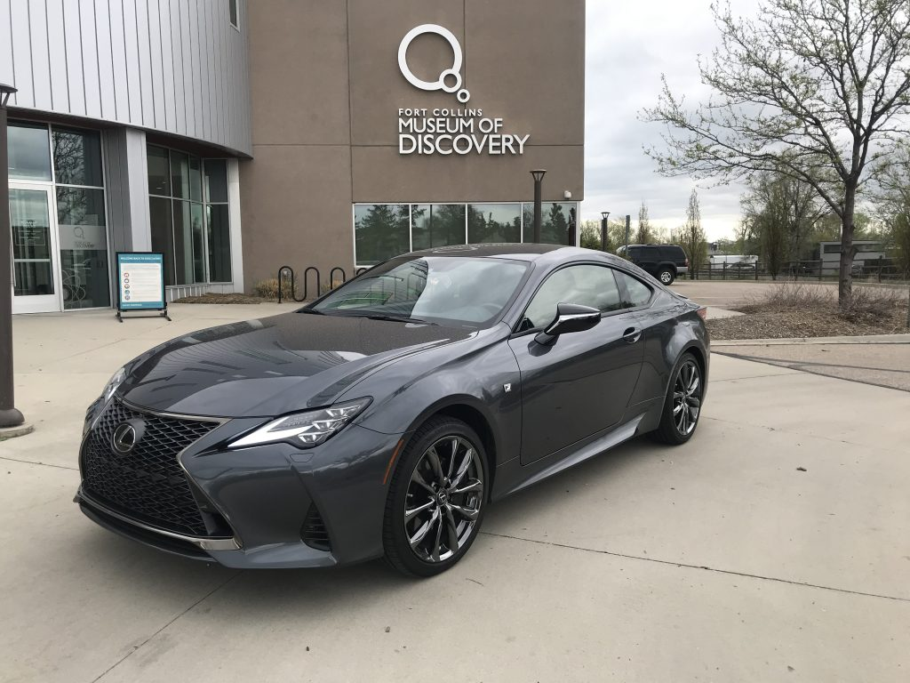 front three quarter shot of 2021 Lexus RC 350 F Sport  in front of a museum