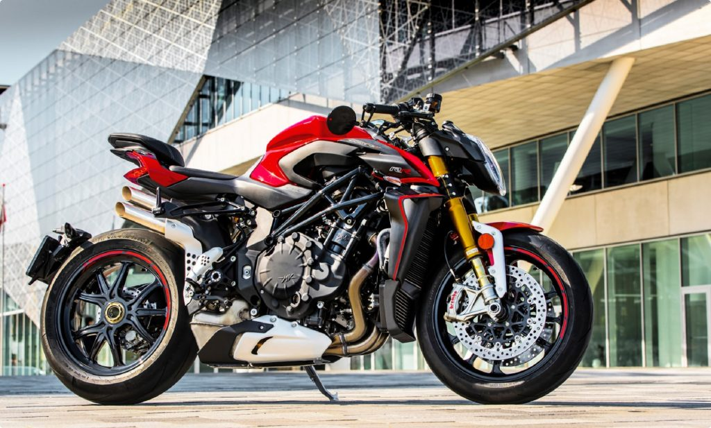 The side view of a red-and-black 2021 MV Agusta Brutale 1000 RR in front of a modern building