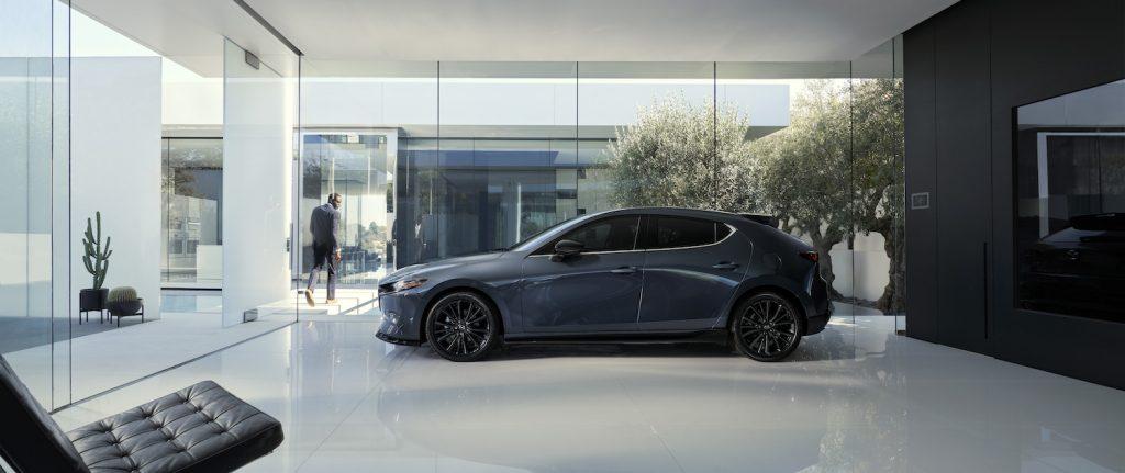 A dark grey 2021 Mazda3 Hatch in a building
