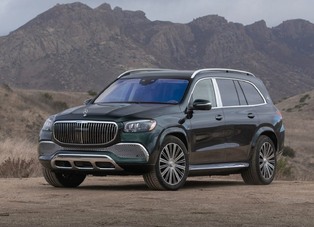 A dark-green 2021 Mercedes-Maybach GLS 600 in the desert next to some mountains