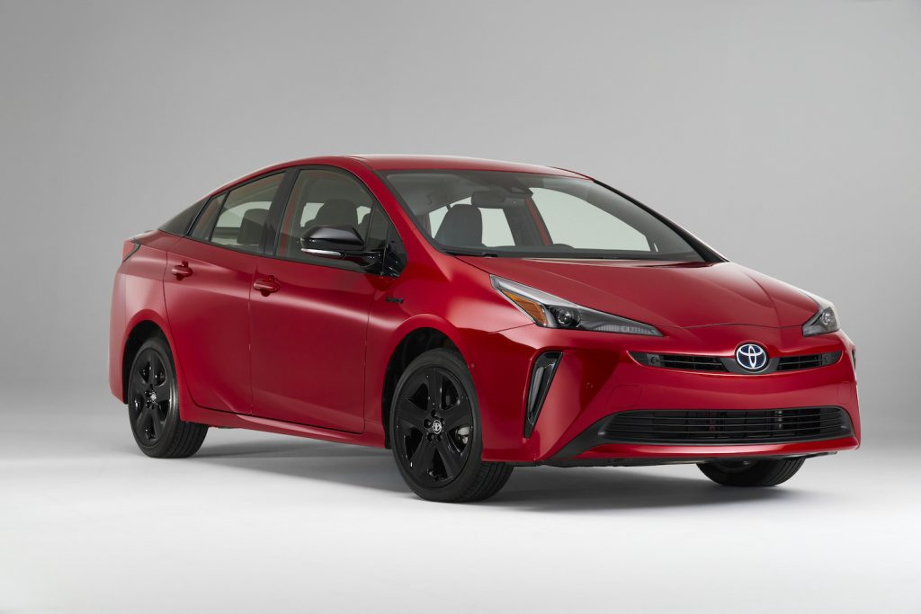 A red 2021 Toyota Prius with nothing behind it