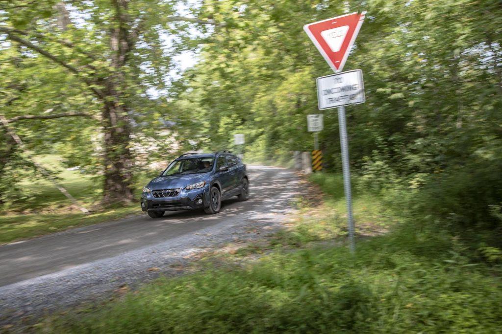 2021 Subaru Crosstrek driving through the forest