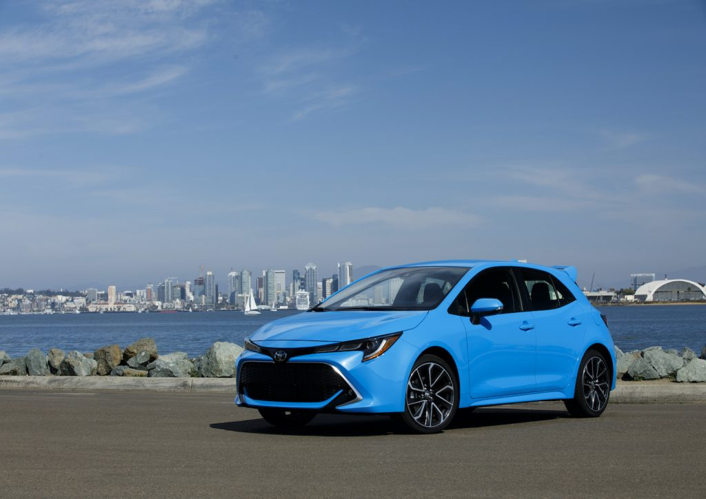 A blue 2021 Toyota Corolla Hatchback, one of the best new affordable cars with a manual transmission