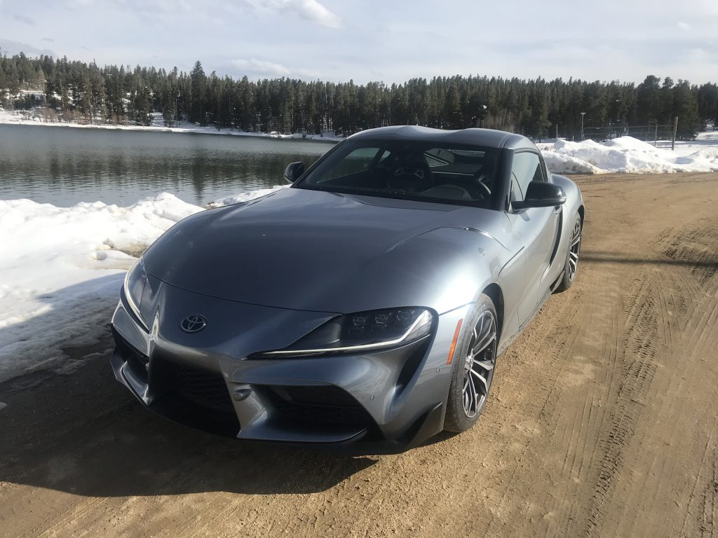 2021 Toyota Supra sitting next to a lake