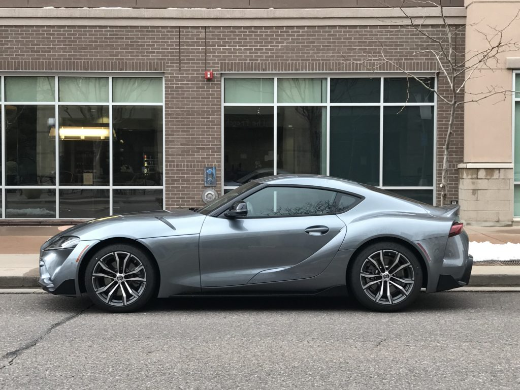 a side shot of the 2021 Toyota Supra on a city street