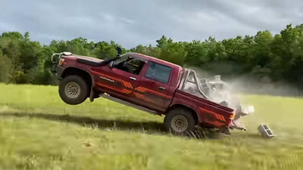 Toyota Hilux popping a wheelie becuase its full of bricks