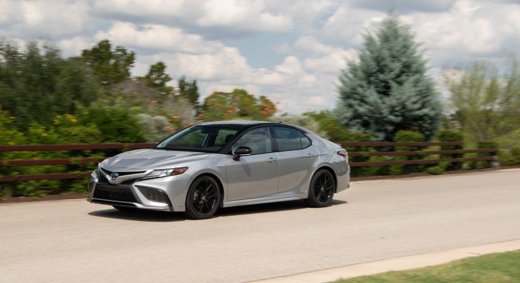A silver 2021 Toyota Camry Hybrid