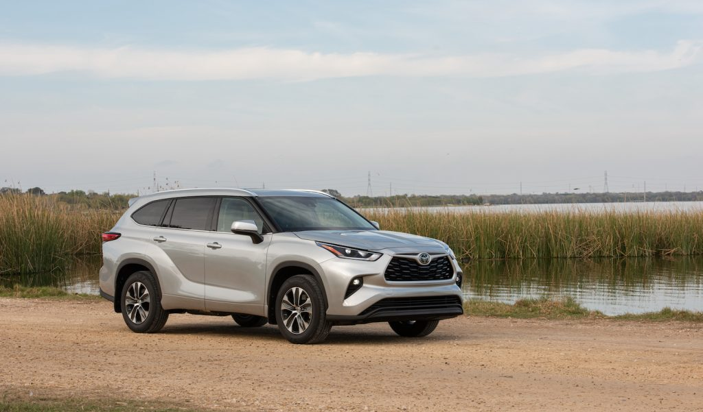 A silver 2021 Toyota Highlander parked, the Highlander is a three-row SUV often compared to the 2021 Subaru Ascent