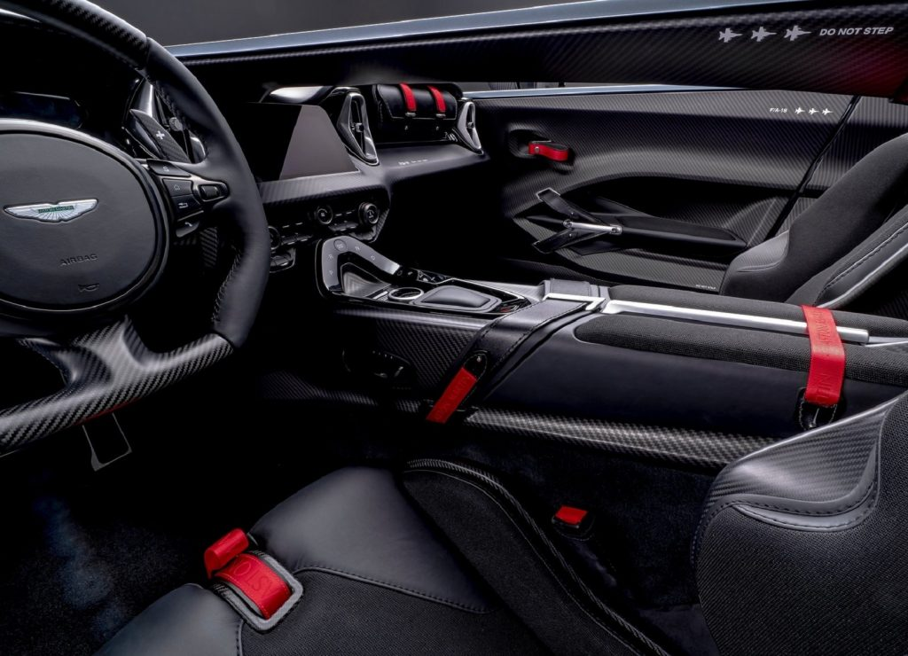 The carbon-fiber-and-leather black-and-red interior of a 2022 Aston Martin V12 Speedster