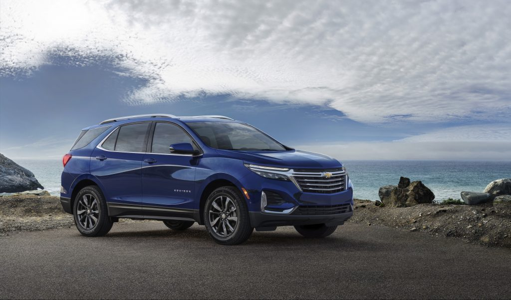 A blue 2022 Chevy Equinox SUV parked on a hill