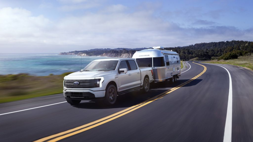 The 2022 Ford F-150 Lightning Lariat seen towing an RV, the F-150 Lightning is Ford's first electric pickup truck