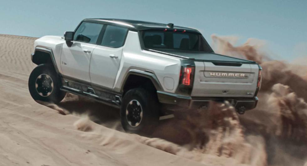2022 GMC Hummer kicking up sand at the dunes