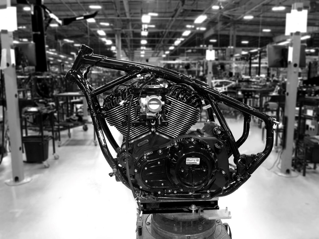 The black frame of a 2022 Indian Chief on a stand with its V-twin installed