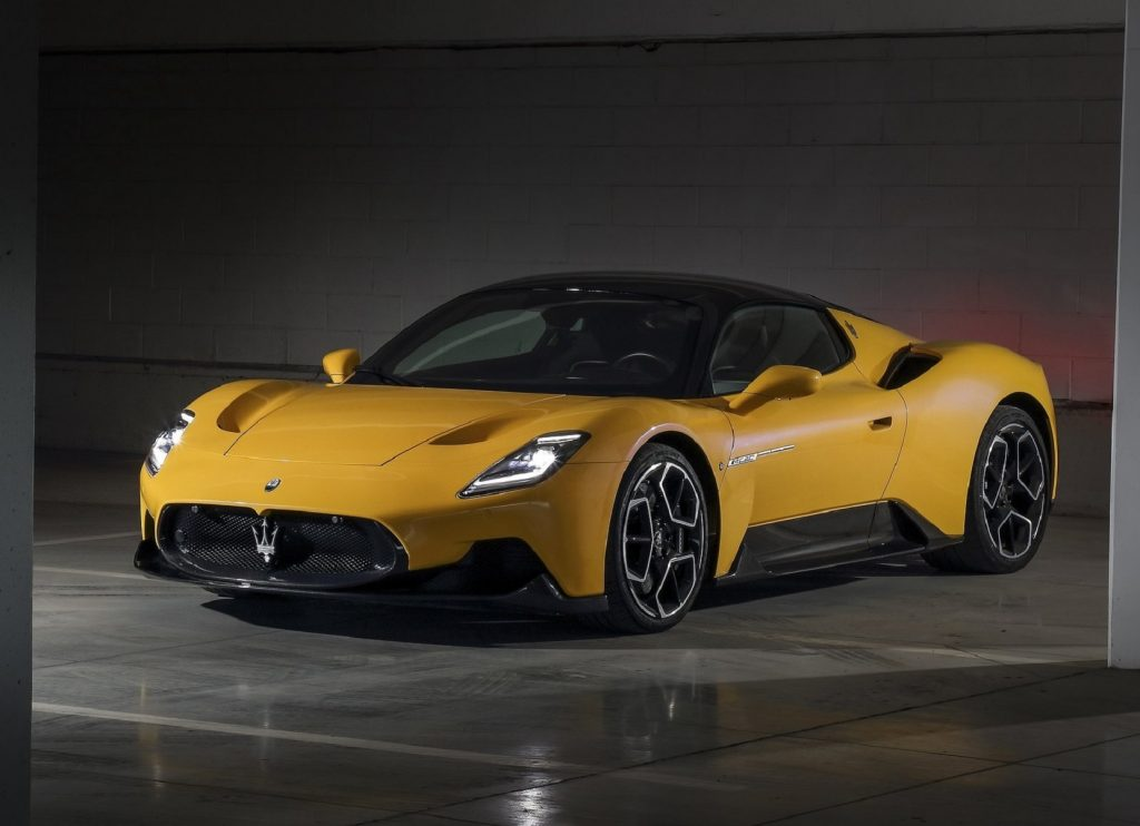A yellow 2022 Maserati MC20 in a garage