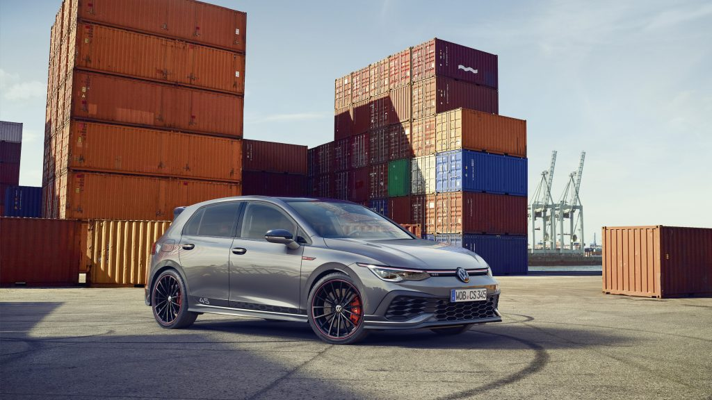 Silver 2022 Volkswagen Golf GTI Clubsport 45 sedan parked in front of shipping containers