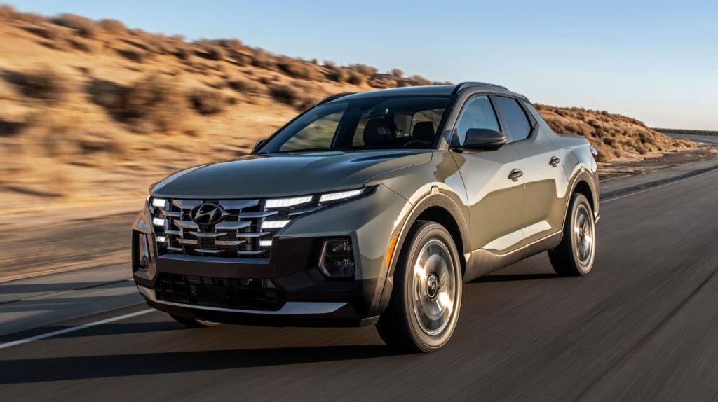 The 2022 Hyundai Santa Cruz driving down a road in the desert.