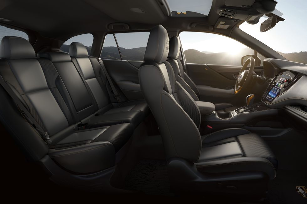 A side shot of the 2022 Subaru Outback Wilderness interior with black upholstery
