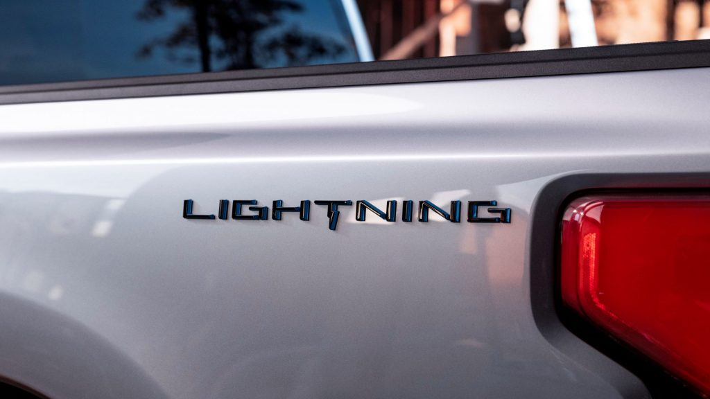 A close-up view of the badge on the side of Ford F-150 Lightning's bed
