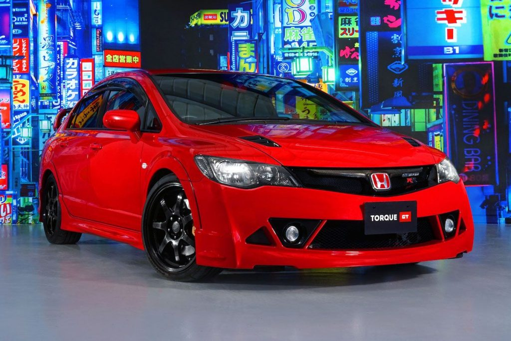 An image of a red Honda Civic Mugen RR in a dealership.