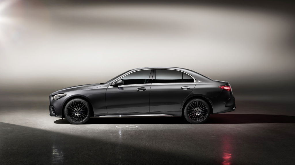 The new Mercedes C-Class in grey sits in a photo booth photographed in profile