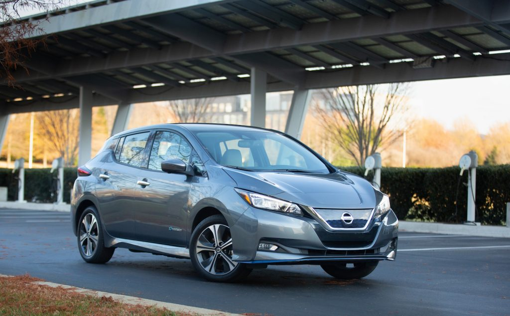 A silver 2021 Nissan Leaf parked on the street, Consumer Reports says the Nissan Leaf is among the best new car deals this Memorial Day