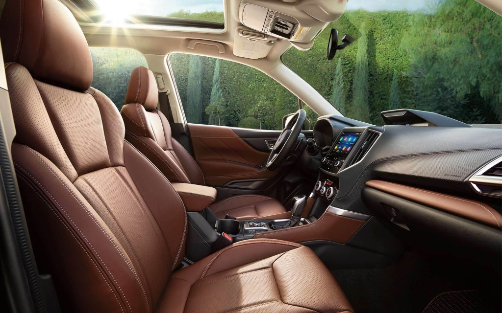 The interior of the 2021 Subaru Forester Touring interior that shows the steering wheel
