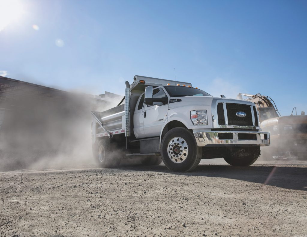 2022 F-750 kicking up a bunch of dust in the desert.