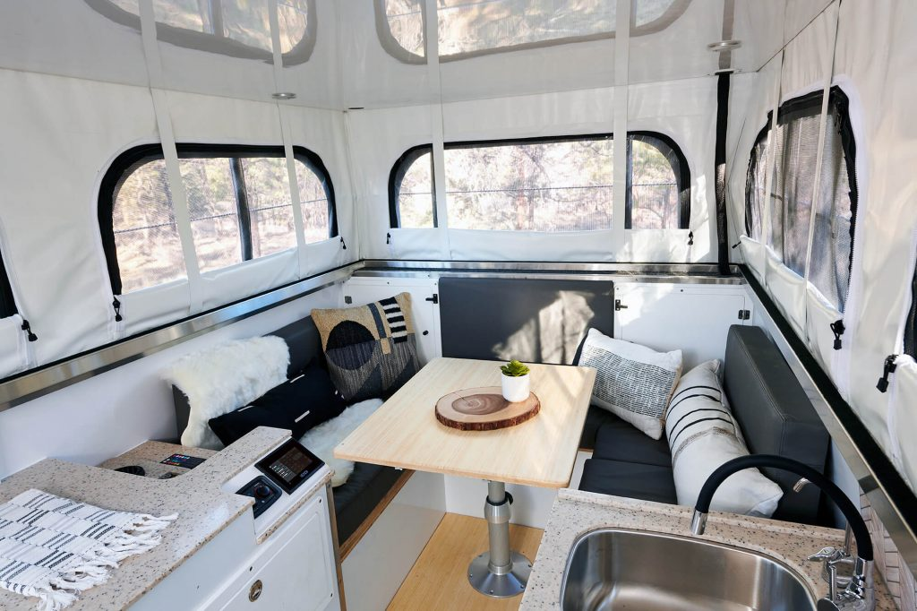go between a dining are/workspace/bedroom in the efficient design of this all-new overland camper