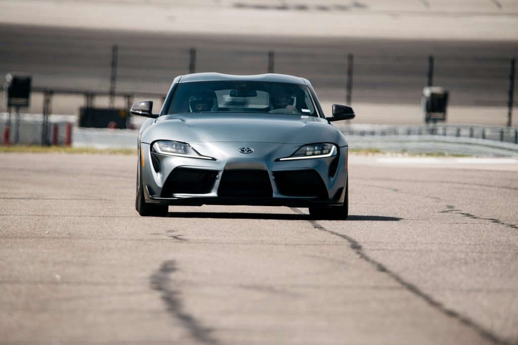 The matte gray 2021 Toyota GR Supra on the track at Texas Motor Speedway for the Texas Auto Roundup